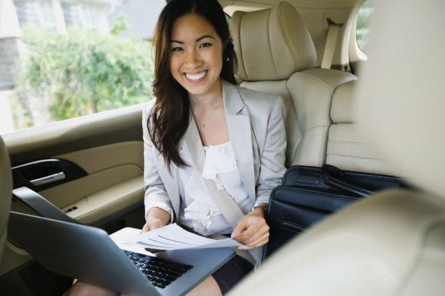 Portrait of businesswoman working in transit